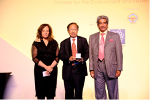 Prof. C.C. Chan (middle) received the WFEO Medal of Engineering Excellence, with WFEO President Alex Al-Kharafi (right) and Executive Director Tuhani Yousef (left), 13 Sep 2013