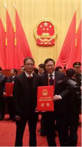 Prof. Jin-Guang Teng (Right) with one of his collaborators, Dr. Lik Lam (Left), at the award ceremony in Beijing